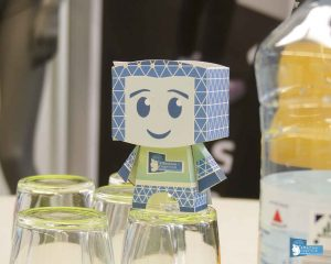 The little paper man with the ACI Design.
